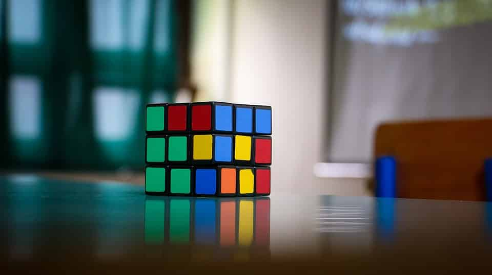an image of an incomplete rubix cube on the table